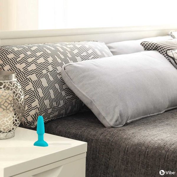 b vibe rimming plug teal by the bed